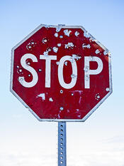 stop_sign_and_bullet_holes