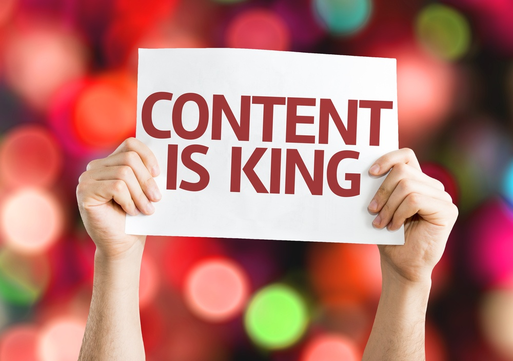 Content is King card with colorful background with defocused lights.jpeg