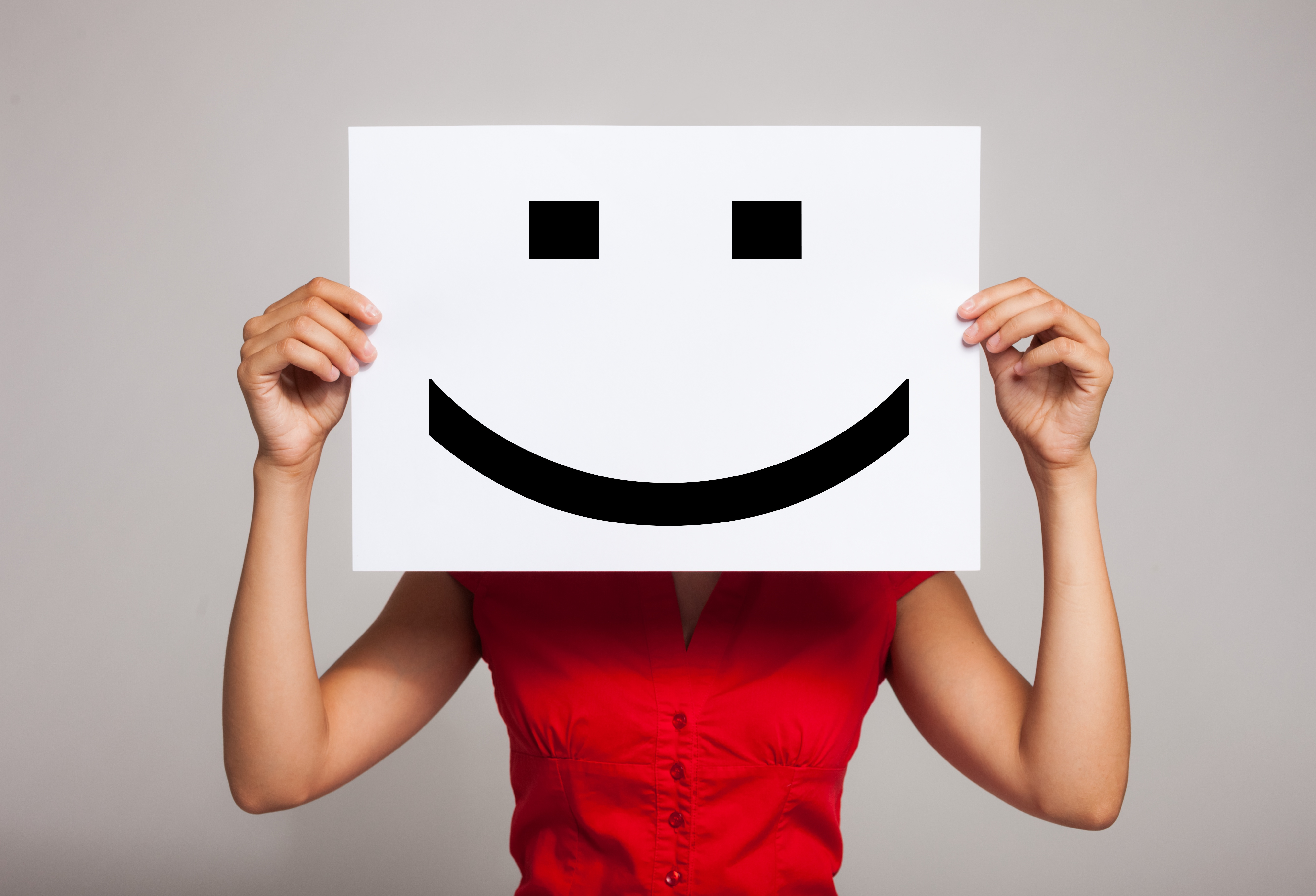 Woman_holding_smiley_face_Up