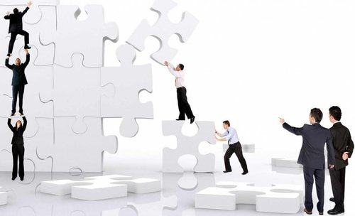 building with puzzle pieces, teamwork, business team, strategy
