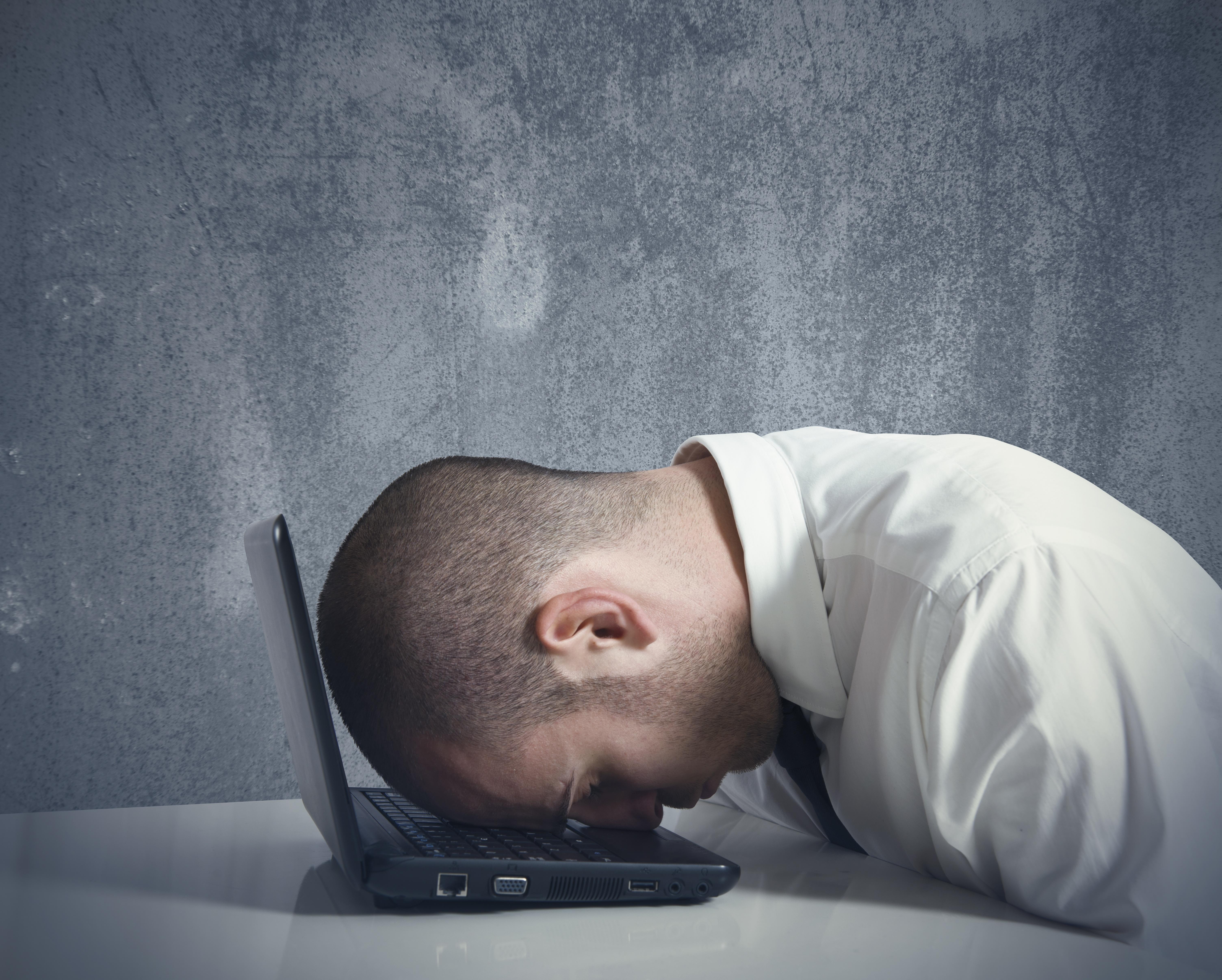 man_with_head_on_laptop.jpg