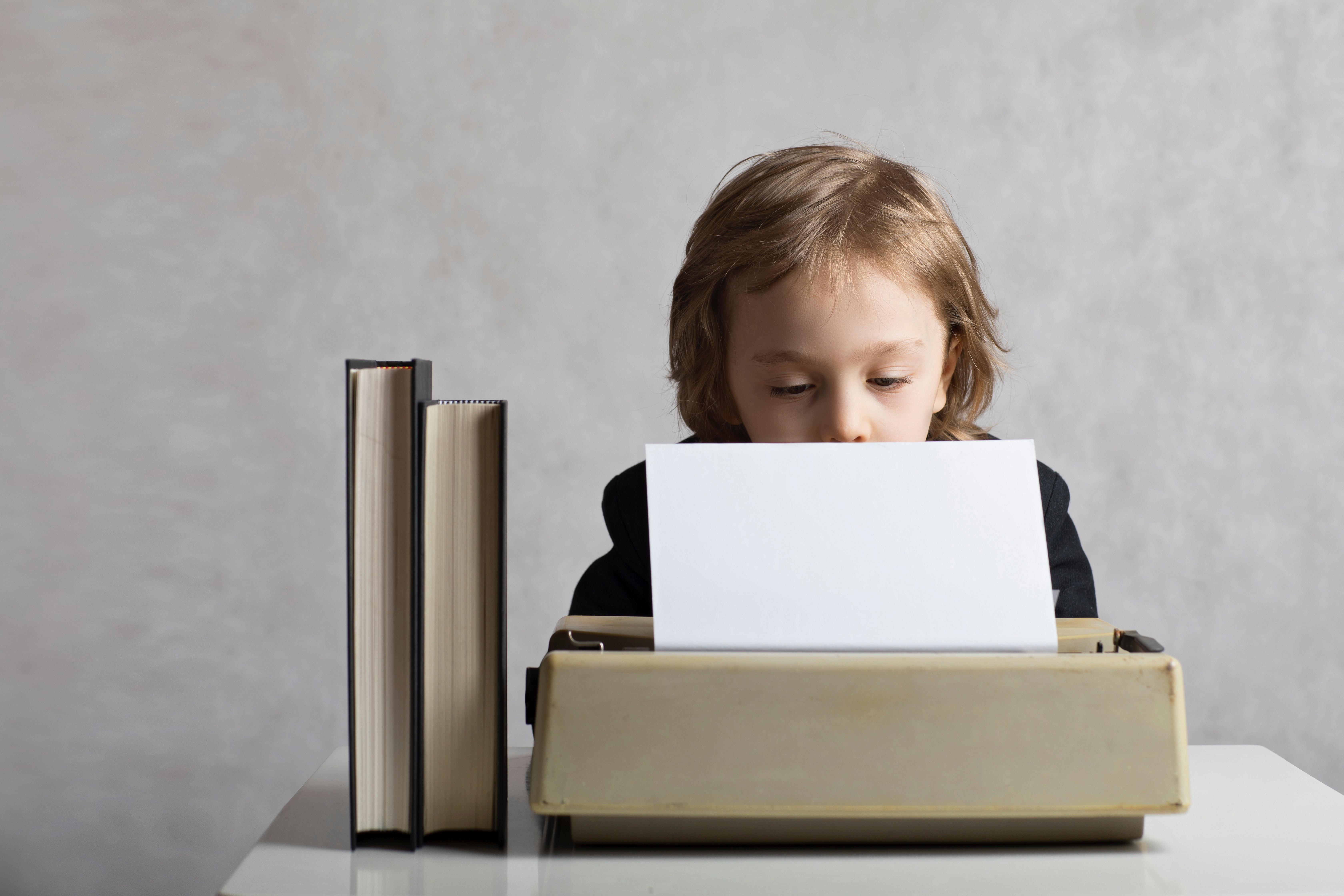 little boy, typewriter, typing, content, blog